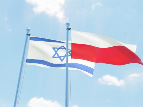 Poland and Israel, two flags waving against blue sky