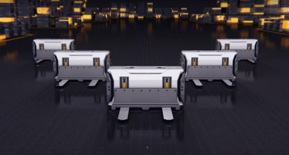 Pięć prostopadłościennych robotów przypominających małe wózki widłowe ustawionych w lancę.