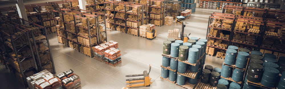 interior of a large warehouse with stored material and means for moving the pallets. 3d render. logistics and manufacturing industry.